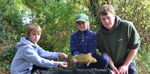 Sam and Adam proudly display their tench