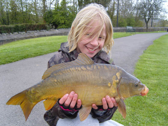 Thomas and his first carp caught using Covert end tackle