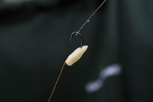 Step 3 -carefully thread the grub onto the hooklink and push the grub over the hook eye